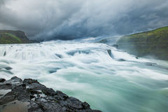 Icelandic waterfall. Beautiful Icelandic waterfall with dramatic sky. It is located in the centre of the island, near Kjolur road Stock Images