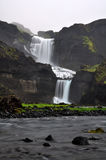 Icelandic waterfall Ofaerufoss. Beautiful Icelandic waterfall Ofaerufoss in canyon  Eldgjá falling in two cascades with a stream in the foreground Stock Photo