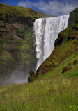 Icelandic waterfall Skogafoss. With huge column of falling water Royalty Free Stock Images