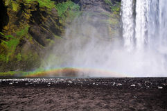 Icelandic waterfall Skogafoss, part of it with a rainbow. Part of the icelandic waterfall Skogafoss with huge column of falling water Stock Photography
