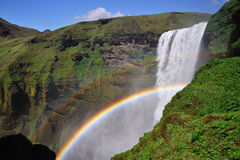 Icelandic waterfall Skogafoss, part of it with a rainbow Stock Images
