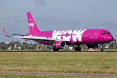 WOW Air. Icelandic WOW Air Airbus A321-200 with registration TF-NOW just landed on runway 18R Polderbaan of Amsterdam Airport Schiphol royalty free stock photo