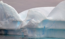 Icerbergs - Antarctica. Icebergs close to shore on the Pleneau Peninsula, Antarctica royalty free stock photos