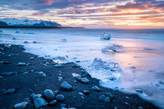 Ices on the beach at Jokulsarlon in southeast Iceland. Jokulsarlon is a large glacial lake in southeast Iceland, on the edge of Vatnajökull National Park Stock Photos