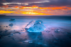 Ices on the beach at Jokulsarlon in southeast Iceland. Jokulsarlon is a large glacial lake in southeast Iceland, on the edge of Vatnajökull National Park Royalty Free Stock Images