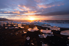 Ices on the beach at Jokulsarlon in southeast Iceland. Jokulsarlon is a large glacial lake in southeast Iceland, on the edge of Vatnajökull National Park Stock Photography