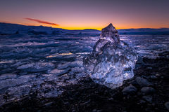 Ices on the beach at Jokulsarlon in southeast Iceland. Jokulsarlon is a large glacial lake in southeast Iceland, on the edge of Vatnajökull National Park Stock Image