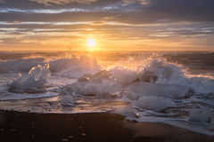 Ices on the beach at Jokulsarlon in southeast Iceland. Jokulsarlon is a large glacial lake in southeast Iceland, on the edge of Vatnajökull National Park Royalty Free Stock Photo