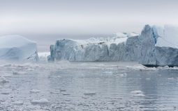 Ices and icebergs of polar regions of Earth. Royalty Free Stock Image