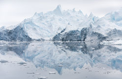Ices and icebergs of polar regions of Earth. Stock Photo