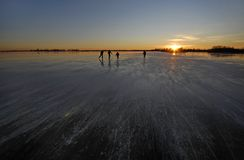 Iceskating on a dutch lake Stock Photo