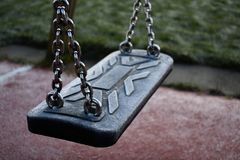 Icey Empty Swing In A Playground stock image