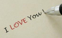 Ich liebe dich Anmerkung - Schreiben auf einem gelben Papier Stockbild