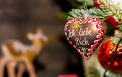 Ich liebe dich (I love you). Heart-shaped Christmas ornament at a Christmas Market, depicting a gingerbread heart with the words I love you in German language Royalty Free Stock Image