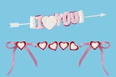 Ich liebe dich Pfeil mit Herzen und Schleife Lizenzfreies Stockbild