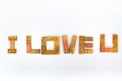 Ich liebe dich trennten hölzerne Dominos Stockbilder