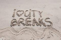 Ich liebe die Städtereisemitteilung, die auf Sand, Ferienkonzept geschrieben wird, der angewendete Farbfilter Lizenzfreies Stockfoto