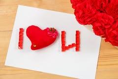 Ich liebe u-Zeichen mit Handmaidblumen Stockfotografie