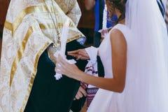Ich ręki w ręczniku w kościół obraz stock