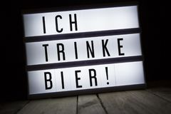 Ich trinke bier I drink beer. `Ich trinke bier` text in lightbox - German for: I drink beer Royalty Free Stock Photography