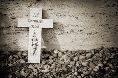 Cross on a grave royalty free stock photos