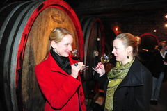 Ich Woman tasting red wine. Worms, Germany- Februar 10, 2010 - Women tasting different wines in cellar Royalty Free Stock Photo