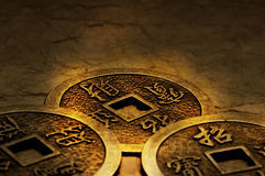 IChing. Three gold coins used for i-ching prophecy in gold lightning