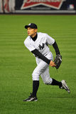 Ichiro Suzuki throwing from outfield. Ishiro Suzuki Yankees baseball player in pinstripe uniform number 31 Royalty Free Stock Photo