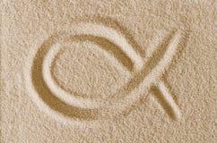 Ichthys, Jesus Fish symbol, drawn in sand macro photo Stock Photo
