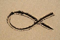 Ichthys symbol. Ichthys, a Christian religious fish symbol, drawn on a beach Stock Images