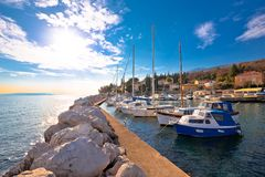 Icici village waterfront and harbor in Opatija riviera. Turquoise sea and blue sky, Kvarner, Croatia Royalty Free Stock Photos
