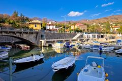 Icici village waterfront and harbor in Opatija riviera. Turquoise sea and blue sky, Kvarner, Croatia Royalty Free Stock Image