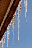 Icicle. On the house roof Royalty Free Stock Photos