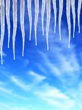 Icicle. S on blue-sky background Royalty Free Stock Photos