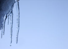 Icicle and falling Water Drop on the Roof Royalty Free Stock Images