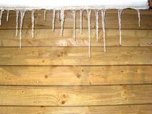icicle in front of a wooden wall stock photos
