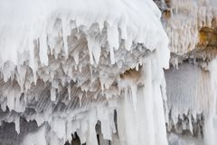 Icicle frozen from ceiling of the cave on Olkhon island on Baikal lake in Siberia royalty free stock photography