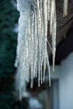 icicle hanging down from roof Royalty Free Stock Images