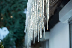 icicle hanging down from roof Stock Photos