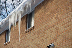 Icicle Hanging on Gutter Stock Image
