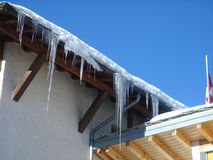 Icicle Hanging from roof Royalty Free Stock Images
