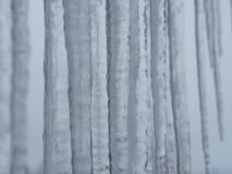 Icicle with grey sky. Icicles with a grey sky as background royalty free stock photography