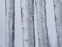 Icicle with grey sky. Icicles with a grey sky as background stock image