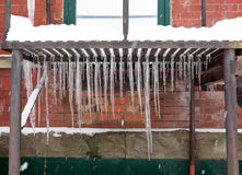 Icicle on Metal Grate Stock Image