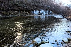 Icicle over a creek Ice Sickles. Icicle over a creek wintertime in missouri beautiful ice sickles royalty free stock photography