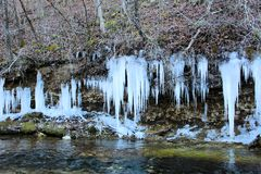 Icicle over a creek Ice Sickles. Icicle over a creek wintertime in missouri beautiful ice sickles stock images