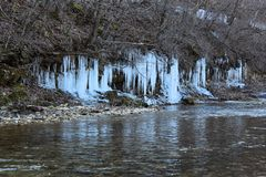 Icicle over a creek Ice Sickles. Icicle over a creek wintertime in missouri beautiful ice sickles royalty free stock image