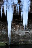 Icicle over a creek Ice Sickles. Icicle over a creek wintertime in missouri beautiful ice sickles royalty free stock photos
