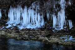 Icicle over a creek Ice Sickles. Icicle over a creek wintertime in missouri beautiful ice sickles royalty free stock photo