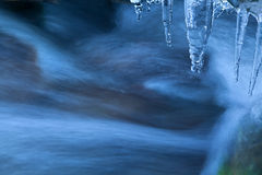 Icicle and river flow Stock Image